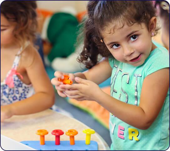 Preschool girl playing