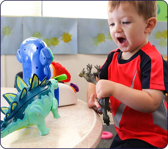 Child playing with toys at toddler daycare in Roswell